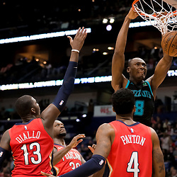 Apr 3, 2019; New Orleans, LA, USA;  Charlotte Hornets center Bismack Biyombo (8) dunks over New Orleans Pelicans guard Elfrid Payton (4) and center Julius Randle (30) and forward Cheick Diallo (13) during the second quarter at the Smoothie King Center. Mandatory Credit: Derick E. Hingle-USA TODAY Sports