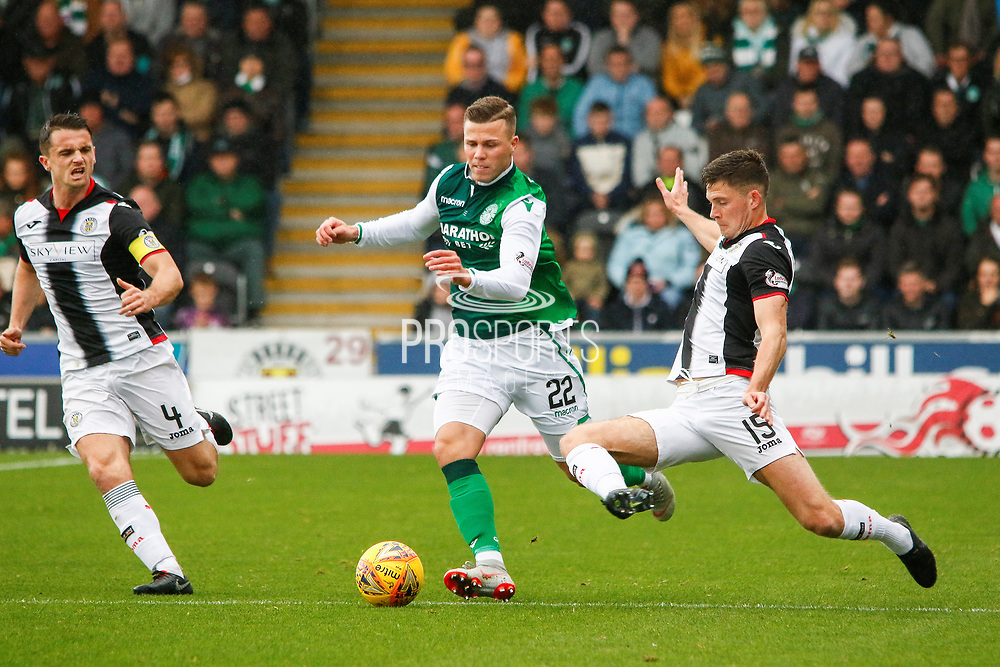 Jack Baird of St Mirren lunges in for the ball against Florian Kamberi of Hiberninan FC during the Ladbrokes Scottish Premiership match between St Mirren and Hibernian at the Simple Digital Arena, Paisley, Scotland on 29th September 2018.
