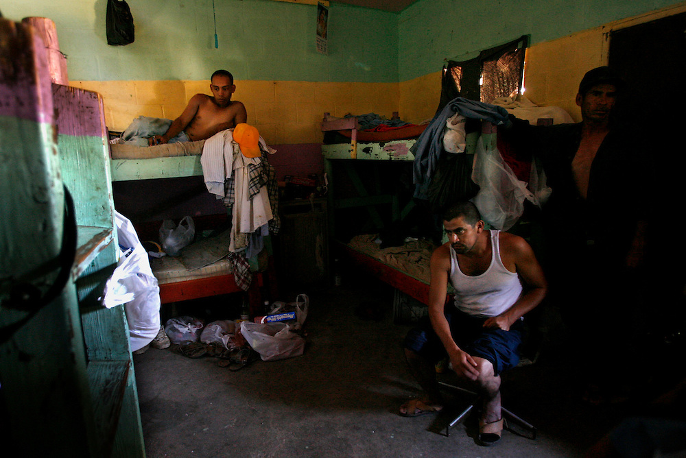 Mecca for Misery.(left to right) Alan Acosta, 20, Jacinto Perez, 28, and Blas Lopez Armenta, 45, escape the afternoon heat in their room after working in the fields in Mecca, Ca. The men share the room with five others and pay $35 per person/per week to rent a room in an illegal residence.