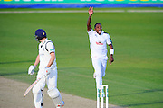 Hampshire's Fidel Edwards takes the last wicket of the day by dismissing Warwickshire's Chris Woakes during the Specsavers County Champ Div 1 match between Hampshire County Cricket Club and Warwickshire County Cricket Club at the Ageas Bowl, Southampton, United Kingdom on 12 April 2016. Photo by Graham Hunt.