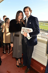 RUPERT FINCH and LADY NATASHA RUFUS-ISAACS at the 2013 Hennessy Gold Cup at Newbury Racecourse, Berkshire on 30th November 2013.