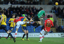 Oxford United's Ryan Clarke punches clear from Exeter City's David Wheeler - Photo mandatory by-line: Neil Brookman/JMP - Mobile: 07966 386802 - 24/01/2015 - SPORT - Football - Oxford - Kassam Stadium - Oxford United v Exeter City - Sky Bet League Two