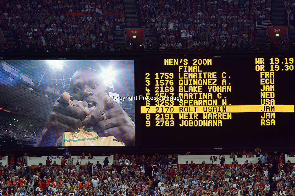 Usain Bolt of Jamaica shown on the big screen along with his results from the Mens 200m Final at the Olympic Stadium, London, England, 9 August 2012.<br /> Photo: Andrew Cornaga/Photosport.co.nz