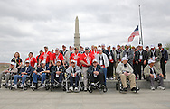 The second of the three busloads of Veterans and guardians pose for a picture during the Sullivan-Hartogh-Davis Post 730 Honor Flight at the National World War II Memorial in Washington, DC on Tuesday, April 16, 2013. About 90 veterans were on the trip. After their visit to the National World War II Memorial they would take a bus tour of Washington, DC followed by a visit to the Korean War Veterans Memorial.