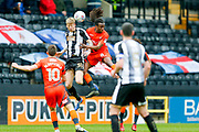 Notts County forward Jonathan Stead (30) wins the header against Wycombe Wanderers midfielder Marcus Bean (8)  during the EFL Sky Bet League 2 match between Notts County and Wycombe Wanderers at Meadow Lane, Nottingham, England on 30 March 2018. Picture by Simon Davies.