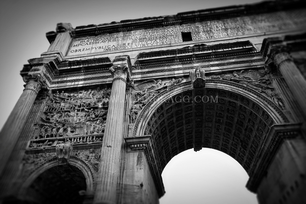 Black and white photo of the historic arch of septimius severus in the roman forum in