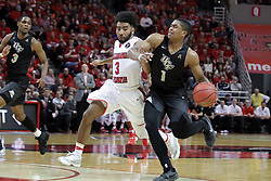 20 March 2017:  B.J. Taylor defended by Keyshawn Evans(3) during a College NIT (National Invitational Tournament) 2nd round mens basketball game between the UCF (University of Central Florida) Knights and Illinois State Redbirds in  Redbird Arena, Normal IL