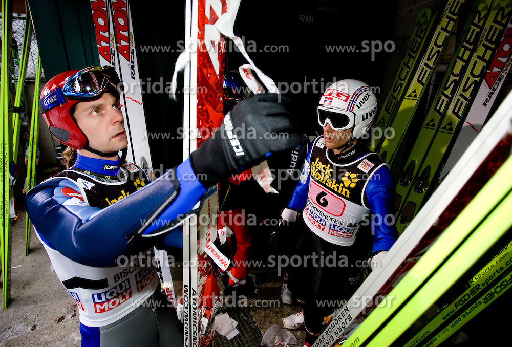 Janne Ahonen of Finland and Bjoern Einar Romoeren of Norway during Trial round of the FIS Ski Jumping World Cup event of the 58th Four Hills ski jumping tournament, on January 6, 2010 in Bischofshofen, Austria. (Photo by Vid Ponikvar / Sportida)