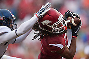 FAYETTEVILLE, AR - NOVEMBER 22:  Keon Hatcher #4 of the Arkansas Razorbacks catches a touchdown pass in the first half of a game against the Ole Miss Rebels at Razorback Stadium on November 22, 2014 in Fayetteville, Arkansas.  The Razorbacks defeated the Rebels 30-0.  (Photo by Wesley Hitt/Getty Images) *** Local Caption *** Keon Hatcher