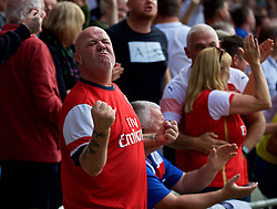 CARDIFF, WALES - Sunday, September 2, 2018: An Arsenal supporter celebrates the winning third goal during the FA Premier League match between Cardiff City FC and Arsenal FC at the Cardiff City Stadium. (Pic by David Rawcliffe/Propaganda)