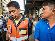 18 AUGUST 2015 - BANGKOK, THAILAND: Thai men look at the damage at the Erawan Shrine Tuesday during the investigation of the bombing of the shrine.  An explosion at Erawan Shrine, a popular tourist attraction and important religious shrine in the heart of the Bangkok shopping district killed at least 20 people and injured more than 120 others, including foreign tourists, during the Monday evening rush hour. Twelve of the dead were killed at the scene. Thai police said an Improvised Explosive Device (IED) was detonated at 18.55. Police said the bomb was made of more than six pounds of explosives stuffed in a pipe and wrapped with white cloth. Its destructive radius was estimated at 100 meters.    PHOTO BY JACK KURTZ