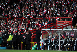 West Ham Manager, Sam Allardyce is backed by Bristol City fans with scarves gifted by the club   - Photo mandatory by-line: Joe Meredith/JMP - Mobile: 07966 386802 - 25/01/2015 - SPORT - Football - Bristol - Ashton Gate - Bristol City v West Ham United - FA Cup Fourth Round