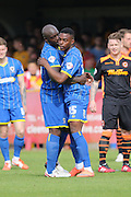Bayo Akinfenwa forward for AFC Wimbledon (10) and Toyosi Olunsanya striker for AFC Wimbledon (35) in action during Sky Bet League 2 match between AFC Wimbledon and Newport County at the Cherry Red Records Stadium, Kingston, England on 7 May 2016. Photo by Stuart Butcher.