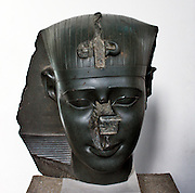 Head from a statue of a king. Thirtieth Dynasty, about 370 BC. This royal head is an example of the very fine quality work produced in late period Egypt, often in a choice of very hard stones. Although there is no inscription on the pieve to identify the king, stylistic comparison suggests the it belongs to the thirtieth Dynasty and probably represents King Nectanebo.