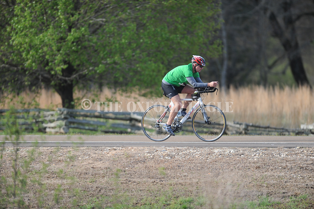 Cyclists ride on old Sardis Road in the 9th Annual Rebel Man Sprint Triathlon in Oxford, Miss. on Sunday, April 6, 2014. Steve Johnson of Longmont, Colo. was the overall winner.
