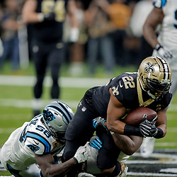 Dec 30, 2018; New Orleans, LA, USA; Carolina Panthers linebacker Jermaine Carter (56) tackles New Orleans Saints running back Mark Ingram II (22) during the first half at the Mercedes-Benz Superdome. Mandatory Credit: Derick E. Hingle-USA TODAY Sports