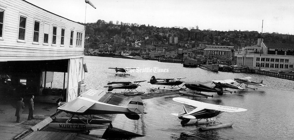 Two seaplanes, arriving and departing at the Kurtzer mooring ramp, were typical of aerial activity on Seattle's busy Lake Union. (Josef Scaylea / The Seattle Times, 1958)