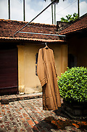 Monk's robe hangs on a clothesline inside a temple courtyard, Hanoi, Vietnam, Southeast Asia