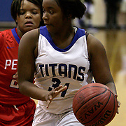 Trask's Saniyah McCallister drives on Pender's Kourtney Messick Tuesday night at Trask High School. (Jason A. Frizzelle)