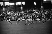 17/08/1969<br /> 08/17/1969<br /> 17 August 1969<br /> All-Ireland Senior Semi-Final: Kilkenny v London at Croke Park, Dublin.<br /> London defender, T. Nolan (4), clears the ball in front of his own goalmouth with three other Kilkenny forwards pressing home the attack.