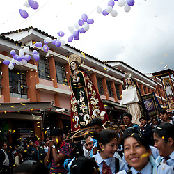 Religious images, including St. John the Baptist and Veronica, are taken in procession on Holy Tuesday through the streets of Ayacucho, Peru.