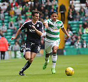 Dundee's Paul McGinn goes past Celtic's Emilio Izaguirre  - Celtic v Dundee - Ladbrokes Premiership at Celtic Park<br /> <br /> <br />  - © David Young - www.davidyoungphoto.co.uk - email: davidyoungphoto@gmail.com