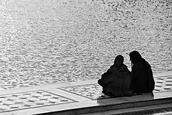 India, Amritsar, 1999. A confidence, perhaps, by the water, in the afternoon light?s reflections from the Golden Temple in Amritsar.