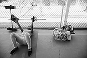 """With him I don't feel so locked up here,"""" said Marcela Perez Soto, 26, as she lifts weights to stay in shape while serving time in a Women's Prison in Chihuahua, Mexico of her 6-month-old son Axel who lays nearby. """"I have another two children, and they live outside. They come here to visit me, they live with my mother."""" In Chihuahua incarcerated women are allowed to keep their children in prison with them, up until age 4."""