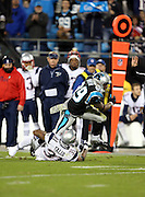 Carolina Panthers wide receiver Steve Smith (89) tries to break free from a tackle attempt by New England Patriots cornerback Aqib Talib (31) as he catches a 5 yard pass good for a first down on third down plus an unnecessary roughness penalty that gives the Panthers the ball at the New England Patriots 19 yard line in the first quarter during the NFL week 11 football game against the New England Patriots on Monday, Nov. 18, 2013 in Charlotte, N.C. The Panthers won the game 24-20. ©Paul Anthony Spinelli