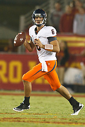September 11, 2010; Los Angeles, CA, USA;  Virginia Cavaliers quarterback Marc Verica (6) scrambles out of the pocket against the Southern California Trojans during the fourth quarter at the Los Angeles Memorial Coliseum. USC defeated Virginia 17-14.