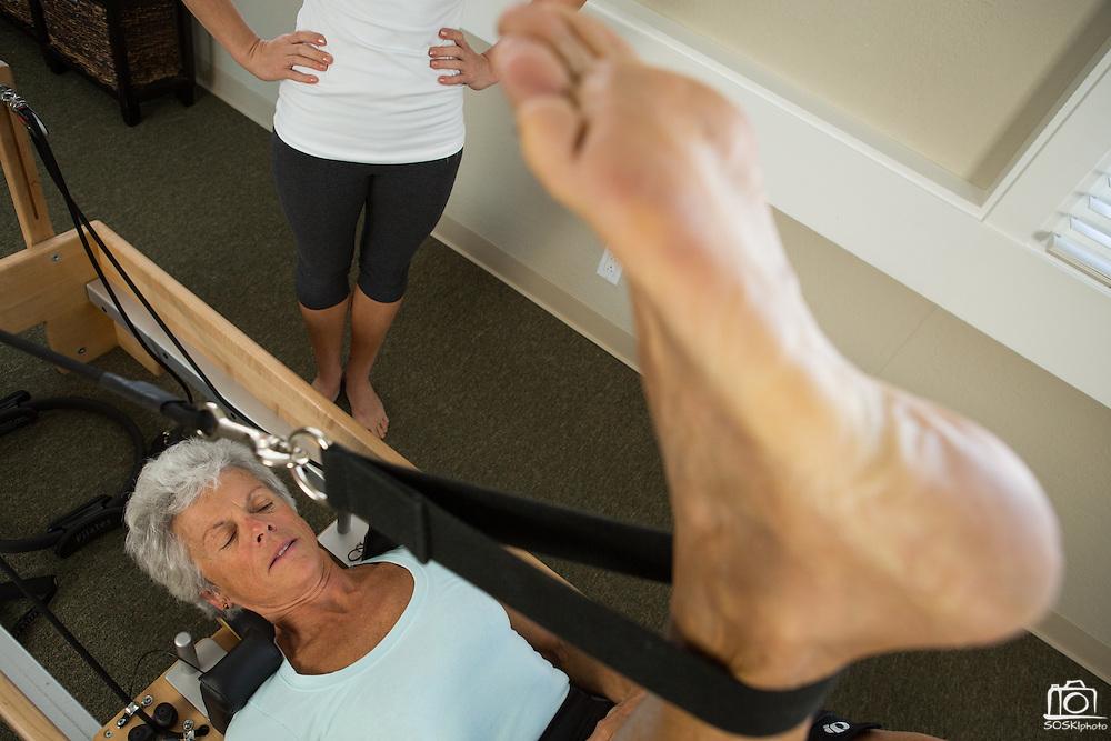 Pilates marketing photos with Lotus Studio owner Liz DeVera in Campbell, California, on May 13, 2013. (Stan Olszewski/SOSKIphoto)