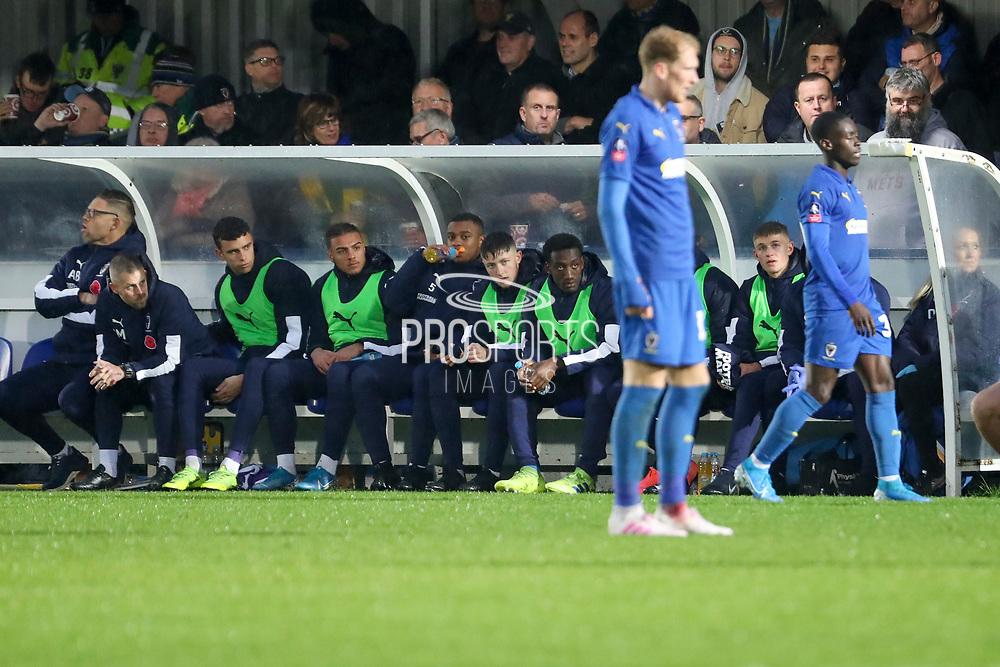 AFC Wimbledon Finlay Macnab (34), AFC Wimbledon attacker Zach Robinson (29) and AFC Wimbledon Jack Madelin (31) sat on the bench during the The FA Cup match between AFC Wimbledon and Doncaster Rovers at the Cherry Red Records Stadium, Kingston, England on 9 November 2019.