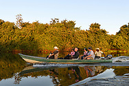 Tourists on a boat trip in the Pantanal, Mato Grosso, Brazil