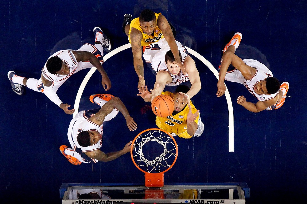 Illinois guard Aaron Cosby (11), guard Kendrick Nunn (25), center Maverick Morgan (22) and guard Malcolm Hill (21) reach for a rebound against Missouri forward Johnathan Williams III (3) and forward D'Angelo Allen (5) during the annual Braggin' Rights game at the Scottrade Center Saturday, Dec. 20, 2014, in St. Louis. Illinois won the game 62-59. (For the Herald & Review/ Stephen Haas)