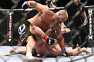 "LONDON, ENGLAND, JUNE 7, 2008: Eddie Sanchez (top) loads up a punch on Antoni Hardonk during ""UFC 85: Bedlam"" inside the O2 Arena in Greenwich, London on June 7, 2008."