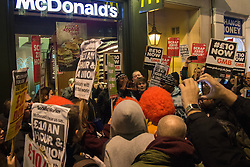 Whitehall, London, January 13th 2016. Protesters gather outside McDonalds in Whitehall ahead of a forum with the Shadow Chancellor John McDonnell at the House of Commons. The protest involving several unions demands £10 per hour for fast food workers, union rights and an end to zero hours contracts.