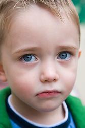 Little boy looking sad,