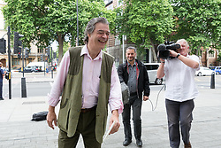 """© Licensed to London News Pictures. 13/07/2017. London, UK. RHODRI PHILIPPS, the 4th Viscount St Davids, arrives at Westminster Magistrates Court in London for sentencing. Philipps was convicted of two counts of sending menacing messages to Brexit campaigner, Gina Miller on a public electronic communications network. He posted: """"£5,000 for the first person to 'accidentally' run over this bloody troublesome first generation immigrant"""" and described her as a """"boat jumper"""".  Photo credit: Vickie Flores/LNP"""