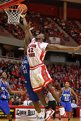 27 January 2008: Dinma Odiakosa tips a ball in by reaching past Todd McCoy in a game where the Indiana State Sycamores were cut down by the Illinois State Redbirds 65-62 on Doug Collins Court at Redbird Arena in Normal Illinois..
