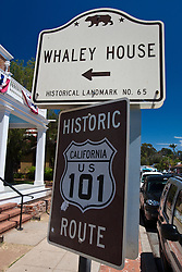 California historical landmark sign in front of Whaley House along with Historic Route US 101 sign, Old Town San Diego, California, United States of America