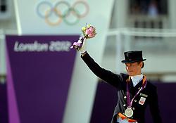 09-08-2012 PAARDENSPORT: OLYMPISCHE SPELEN 2012 DRESSUUR: LONDEN<br /> Adelinde Cornelissen heeft Nederland een zilveren medaille bezorgd. De 33-jarige amazone paradeerde met haar paard Parzival op prachtige wijze door de olympische dressuurring, maar het was net niet goed genoeg voor de olympische titel.<br /> ©2012-FotoHoogendoorn.nl