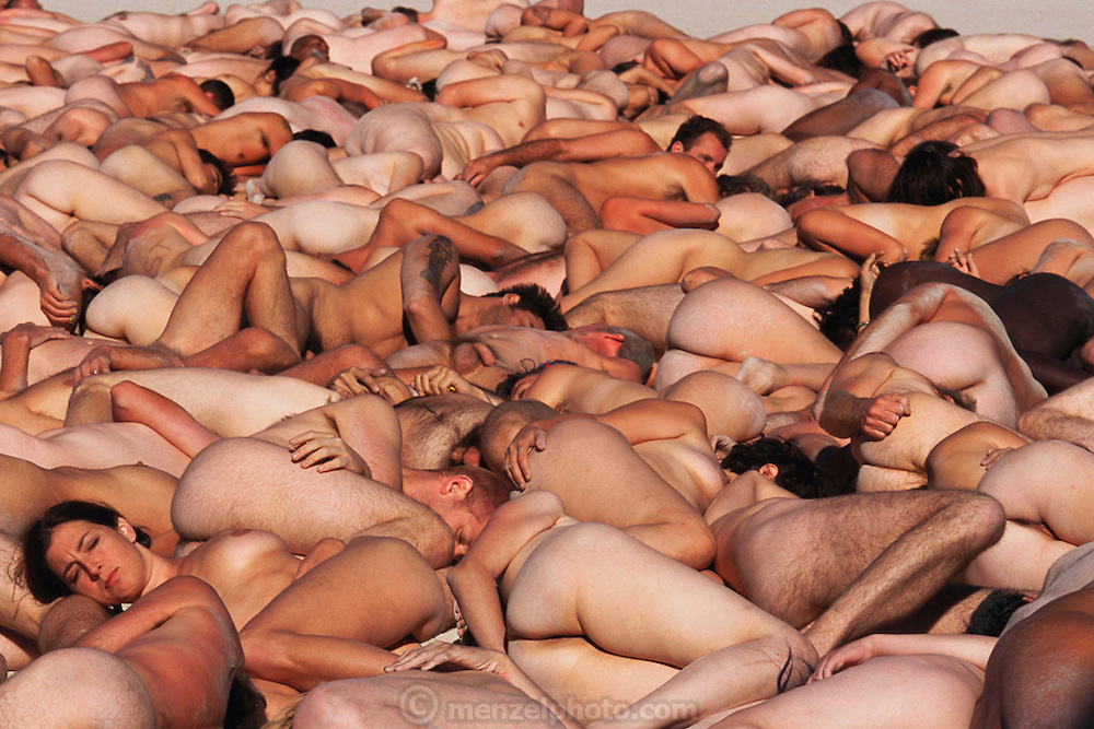 Photographer Peter Menzel's telephoto lens compresses the naked bodies of New York artist Spencer Tunick's production of nudes lying on the desert at the Burning Man Festival in the Black Rock Desert, Nevada. Burning Man is a performance art festival known for art, drugs and sex. It takes place annually in the Black Rock Desert near Gerlach, Nevada, USA..
