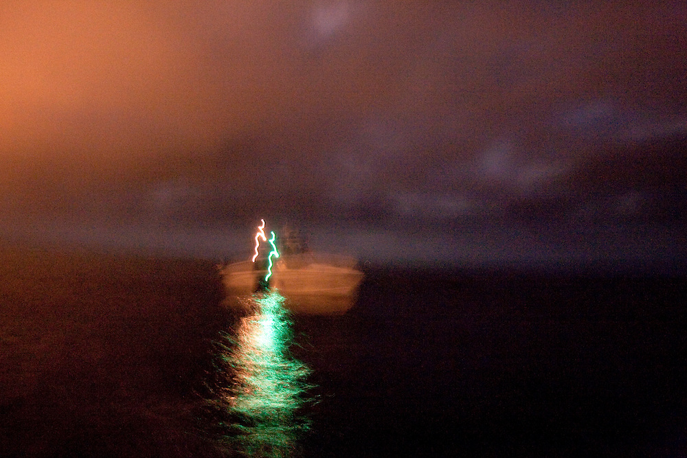 "A Customs and Border Protection boat patrols the Pacific Ocean before dawn near the US/Mexico border for undocumented immigrants as well as gun smugglers attempting to bring guns into Mexico. For more images, search for ""immigration by air and sea"". Please contact Todd Bigelow directly with your licensing requests."