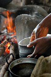 Ghana, Adaklu, Titikope, 2007. The Ghanaian diet relies heavily on tropical crops like cassava, yams and rice. Women often spend much of the day in food preparation.