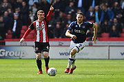 Sheffield United midfielder John Fleck (4) and Millwall FC forward Lee Gregory (9) during the EFL Sky Bet Championship match between Sheffield United and Millwall at Bramall Lane, Sheffield, England on 14 April 2018. Picture by Ian Lyall.