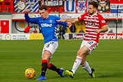 Ryan Jack shrugs off the challenge from Kieran Monlouis  during the Ladbrokes Scottish Premiership match between Hamilton Academical FC and Rangers at The Hope CBD Stadium, Hamilton, Scotland on 24 February 2019.
