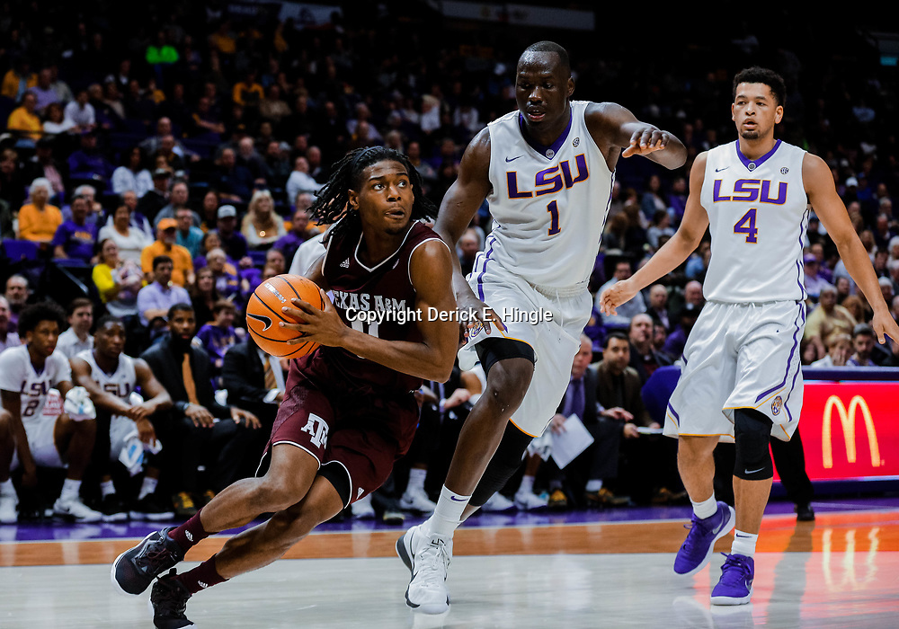Jan 23, 2018; Baton Rouge, LA, USA; Texas A&M Aggies guard Jay Jay Chandler (0) drives past LSU Tigers forward Duop Reath (1) and guard Skylar Mays (4) during the first half at the Pete Maravich Assembly Center. Mandatory Credit: Derick E. Hingle-USA TODAY Sports