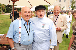 Left to right, SIR STIRLING MOSS and SIR JACKIE STEWART at a luncheon hosted by Cartier for their sponsorship of the Style et Luxe part of the Goodwood Festival of Speed at Goodwood House, West Sussex on 4th July 2010.