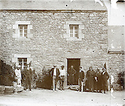 vintage image of family in front of their house