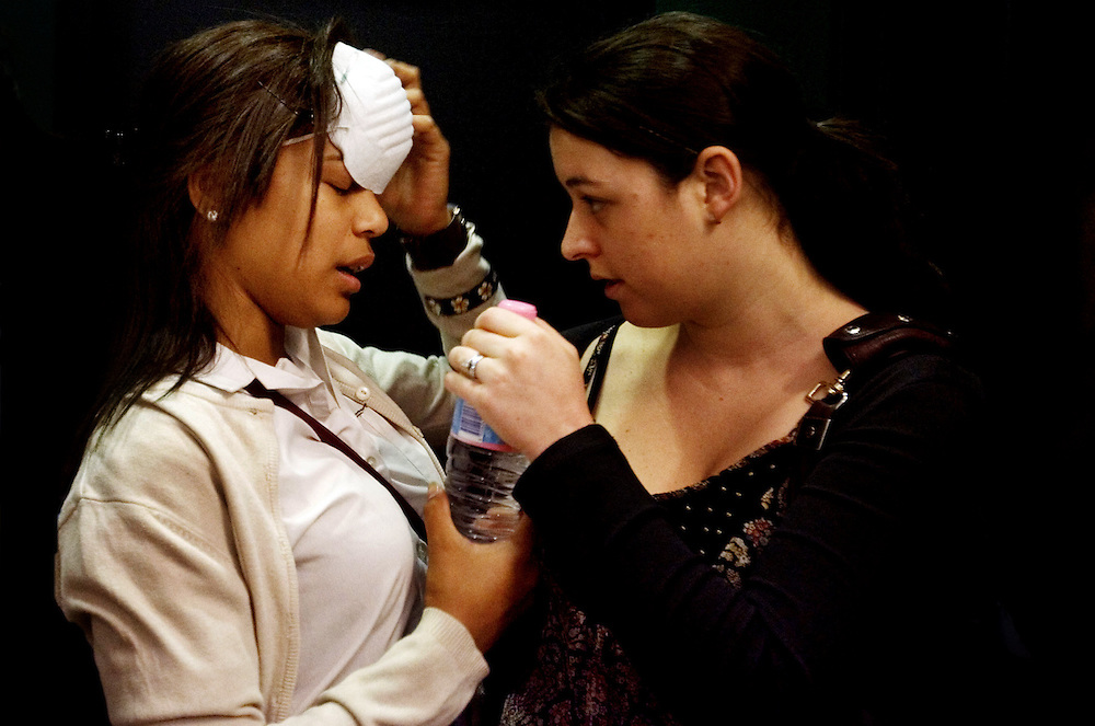 Bidwell Campus student Patricia Raikadroka is assisted by Teacher Tegan Bakerafter suffering breathing difficulties whilst on a school excursion in the CBD, in Sydney, Sep. 23, 2009. (AAP Image/Jenny Evans) NO ARCHIVING